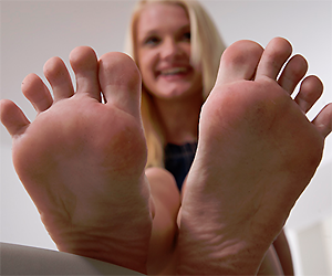 Her small feet on his huge penis
